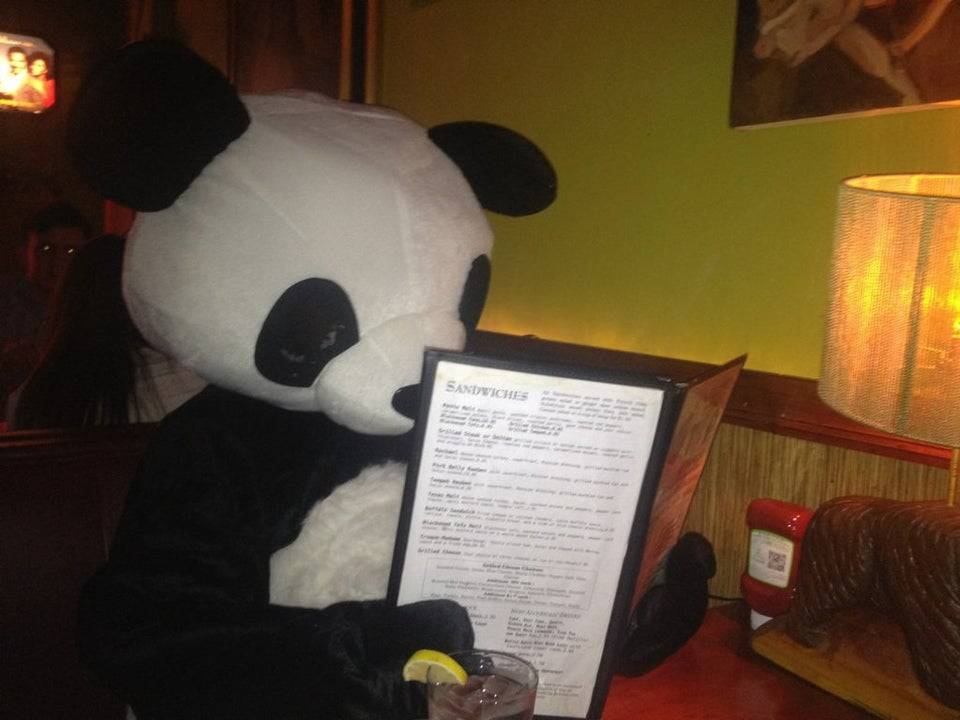 brother showing up to restaurant for dinner dressed as panda