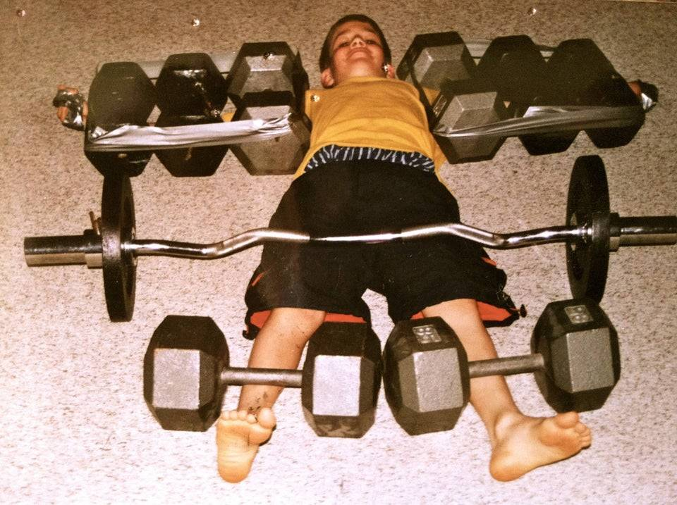 photo of boy who's siblings placed weights all over body so he can't get up