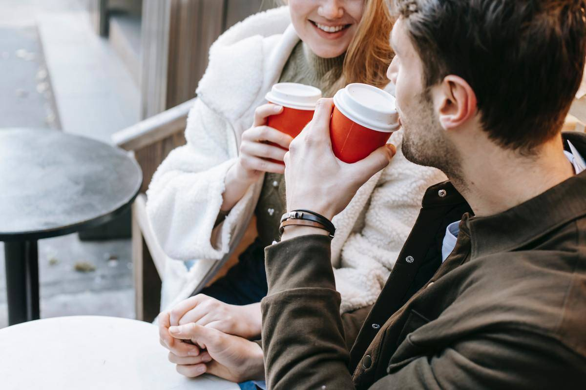 couple sipping coffee outside
