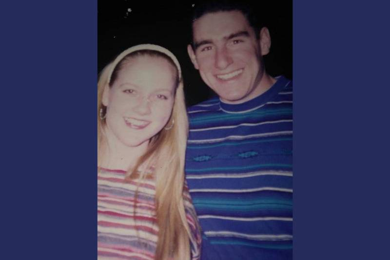 couple in striped shirts smiling