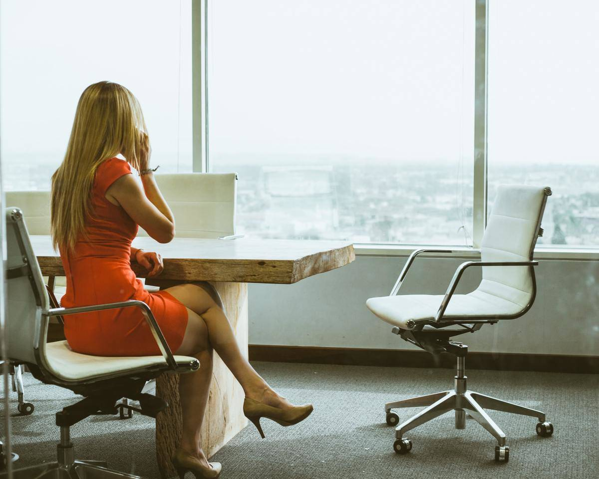 woman in nice dress sitting at conference table