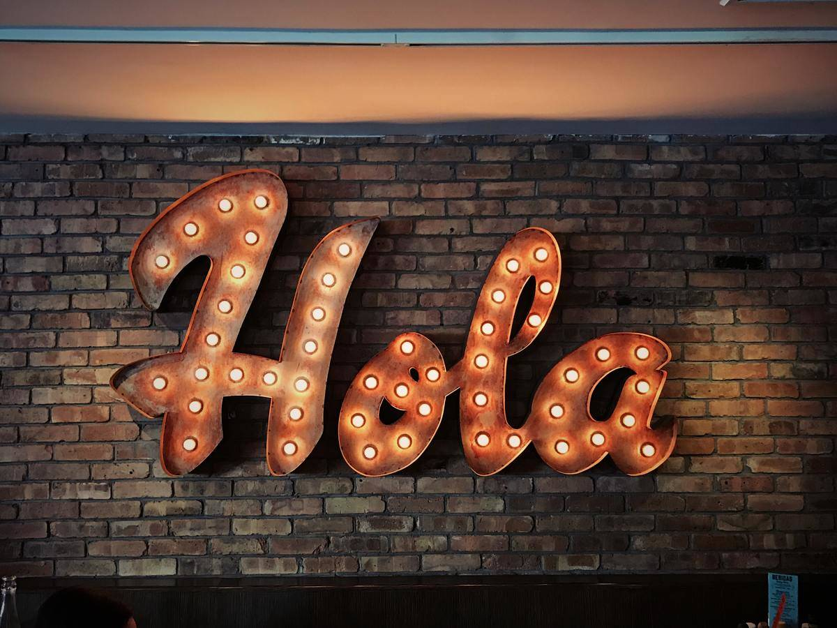 hola sign on the wall
