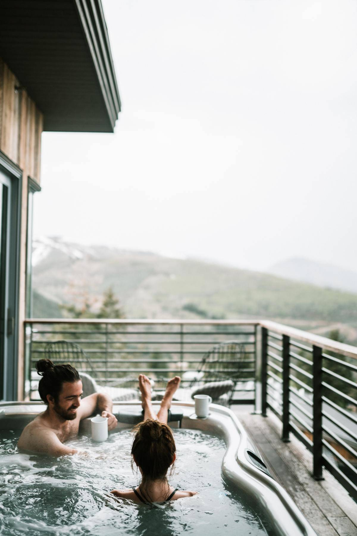 couple sitting in a hot tub outside