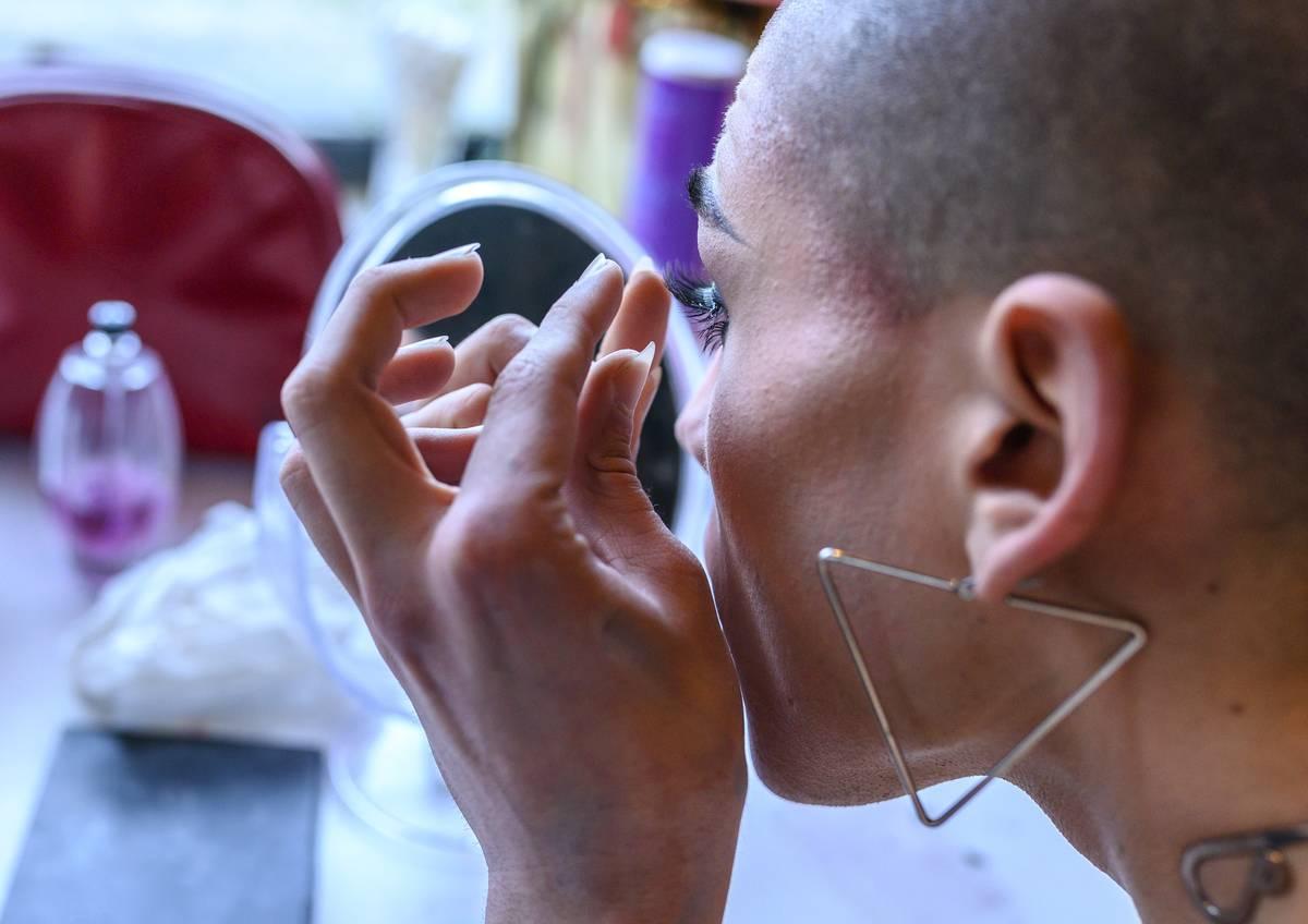 Portuguese Drag Queen performer Diogo Conde (stage name Khaos) applies false eyelashes