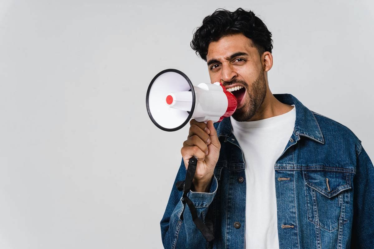 man yelling into a megaphone