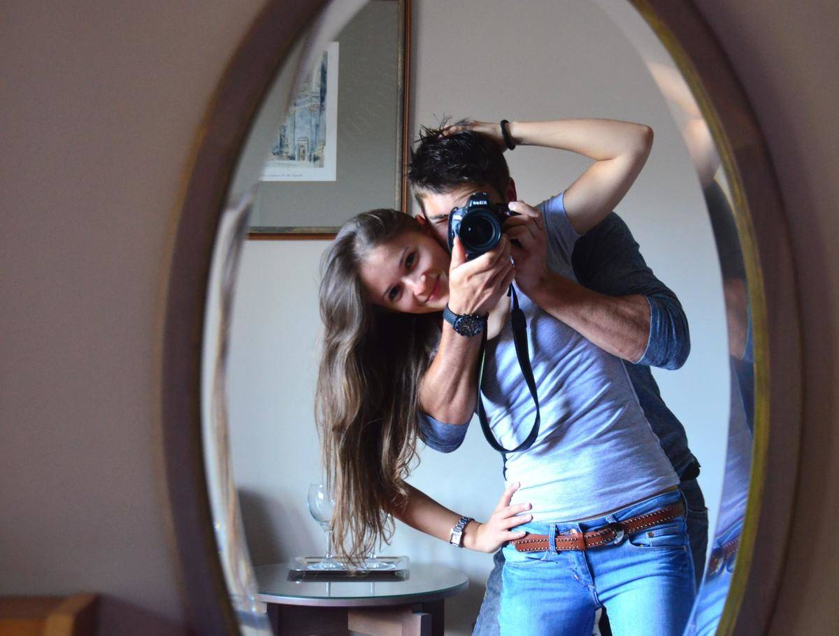 guy and girl taking a selfie while hugging