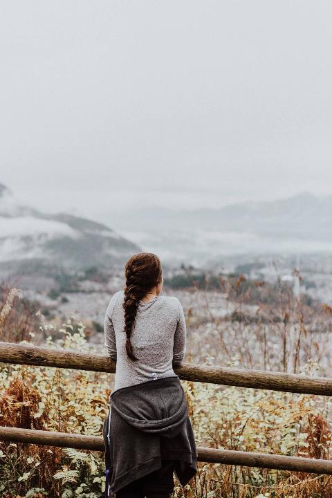 woman looking out over mountains