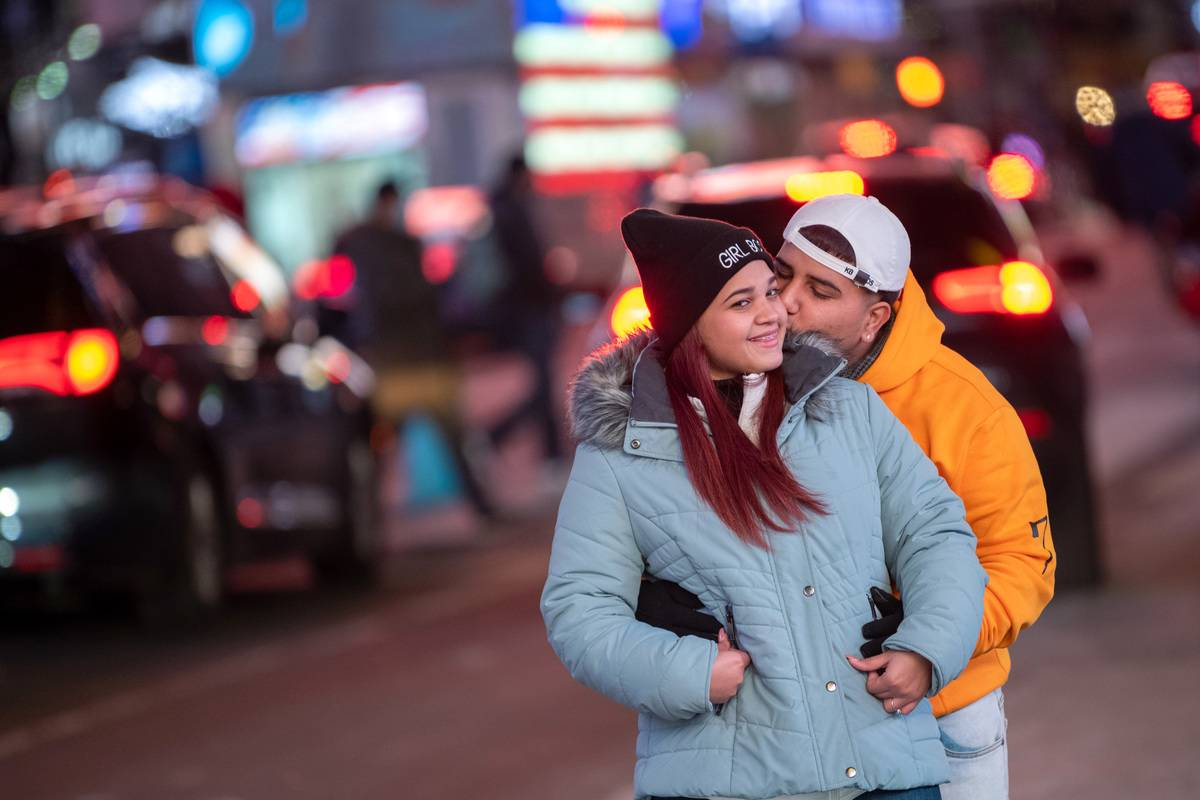 : A couple poses together kissing on Valentine's Day in Times Square on February 14, 2021 in New York City.
