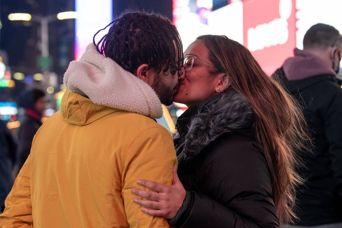 A couple kisses on Valentine's Day in Times Square on February 14, 2021 in New York City.