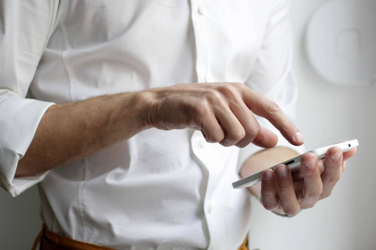 man pointing finger to phone