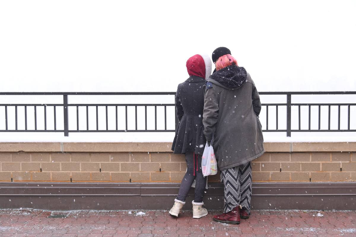 A couple view the shrouded Manhattan skyline from across the Hudson River on February 19, 2021 in Guttenberg, New Jersey
