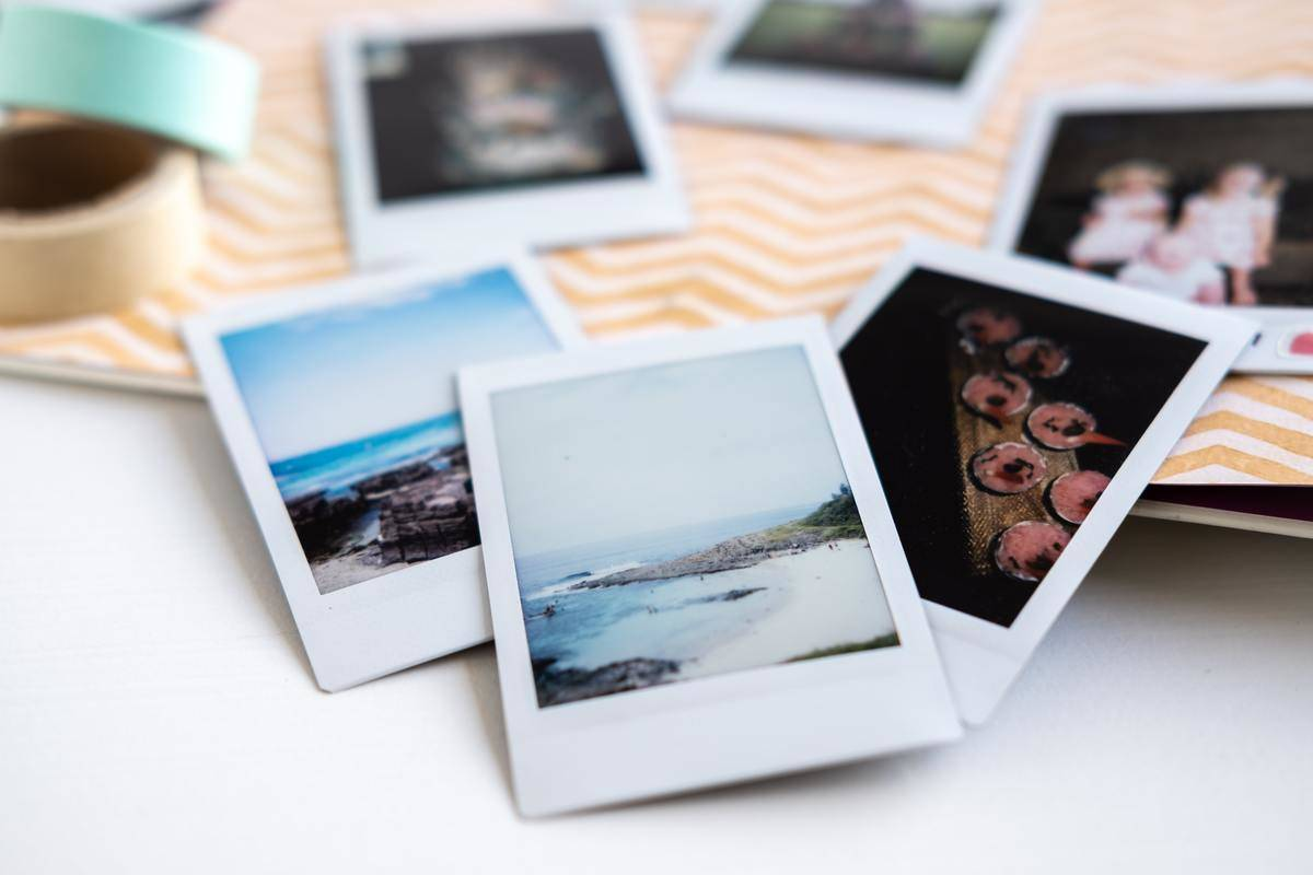 pile of polaroids spread out on desk