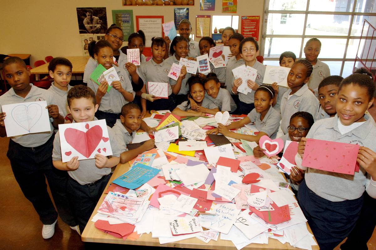 Students of The Andre Agassi Prep School present 1,400 hand made Valentine cards