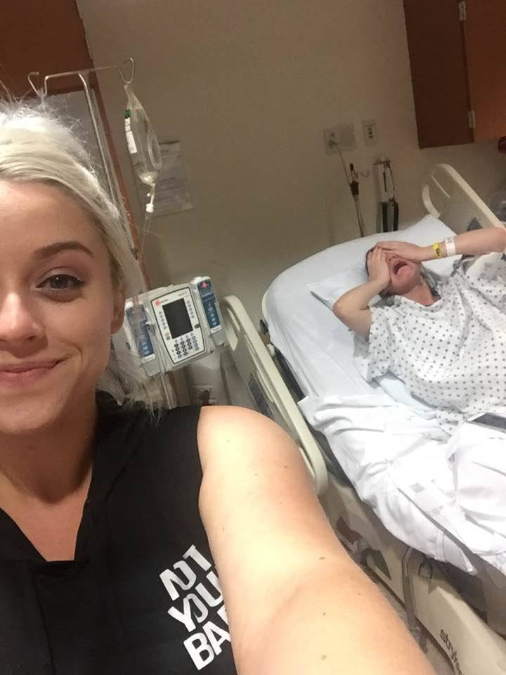 taking selfie while sister is giving birth