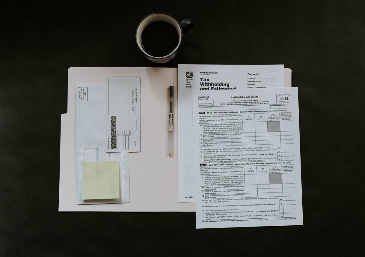 open folder with tax forms inside