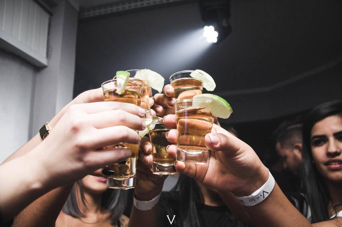 people cheerings tequila shots