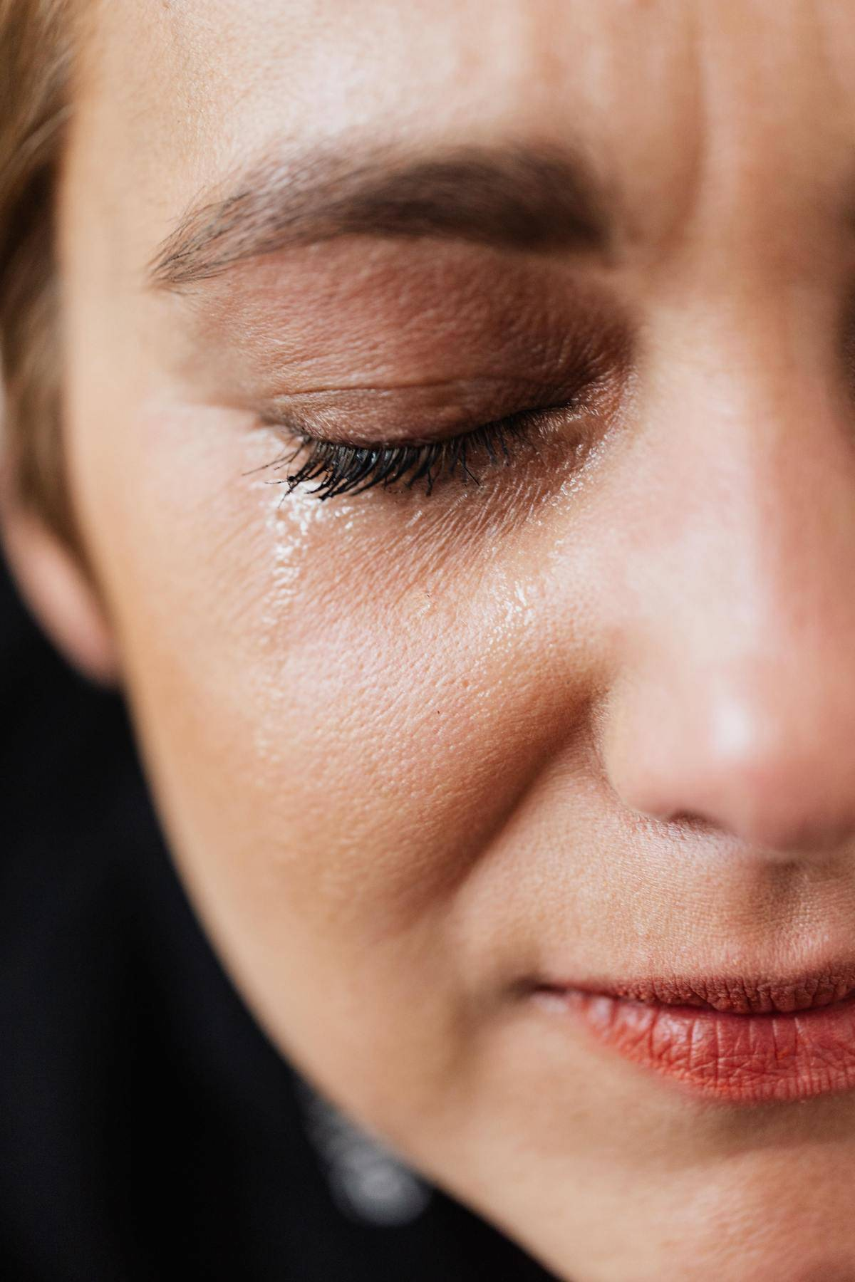 woman with single tear running down her face