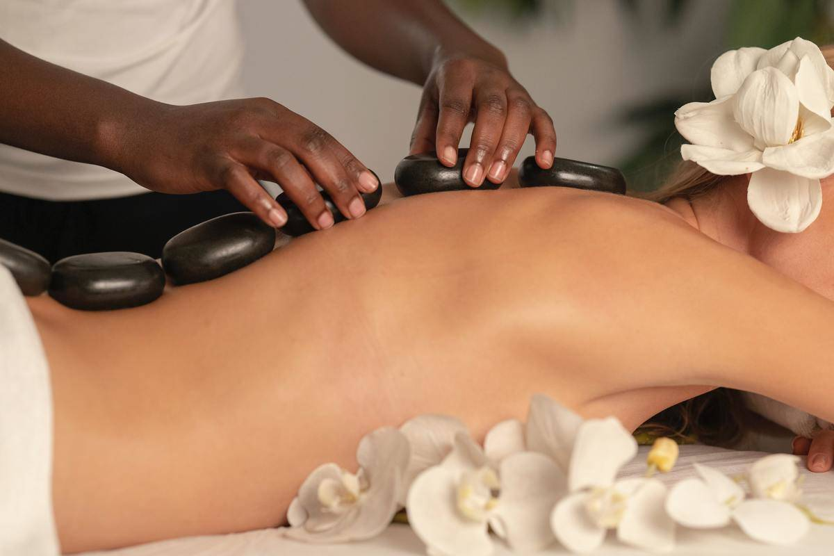 woman getting massage with rocks