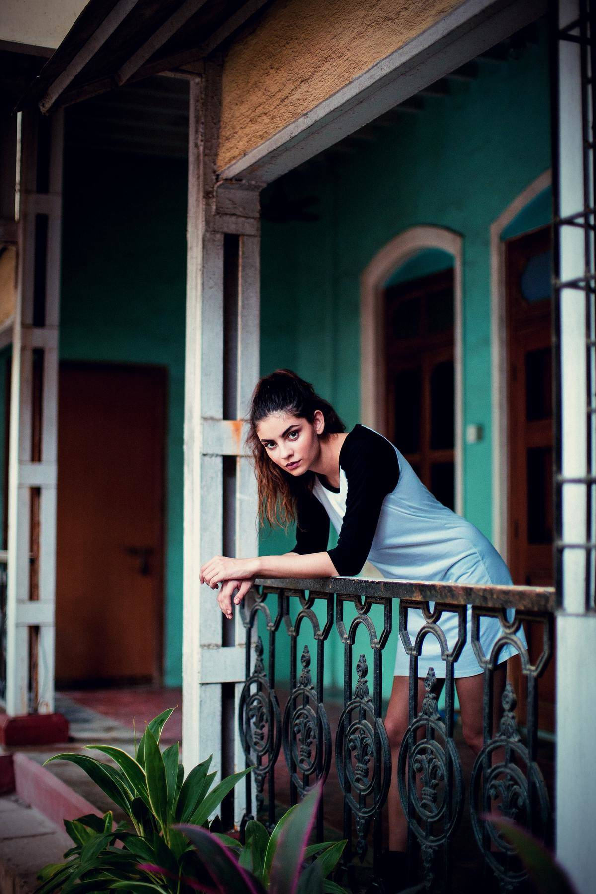 woman looks over from balcony