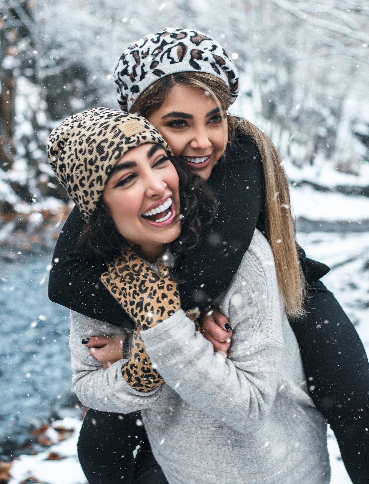 woman piggy back her friend in the snow