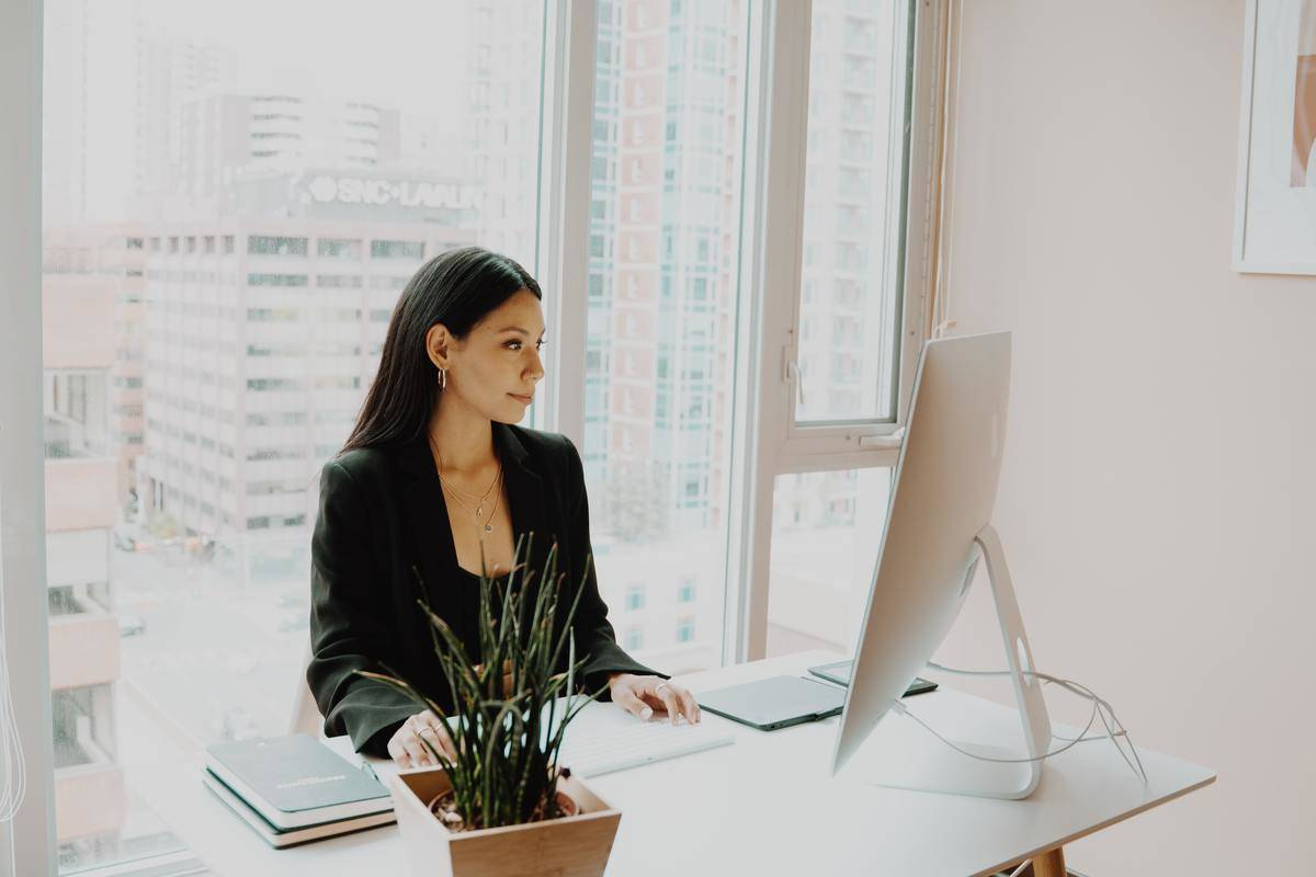 woman at desk in business office
