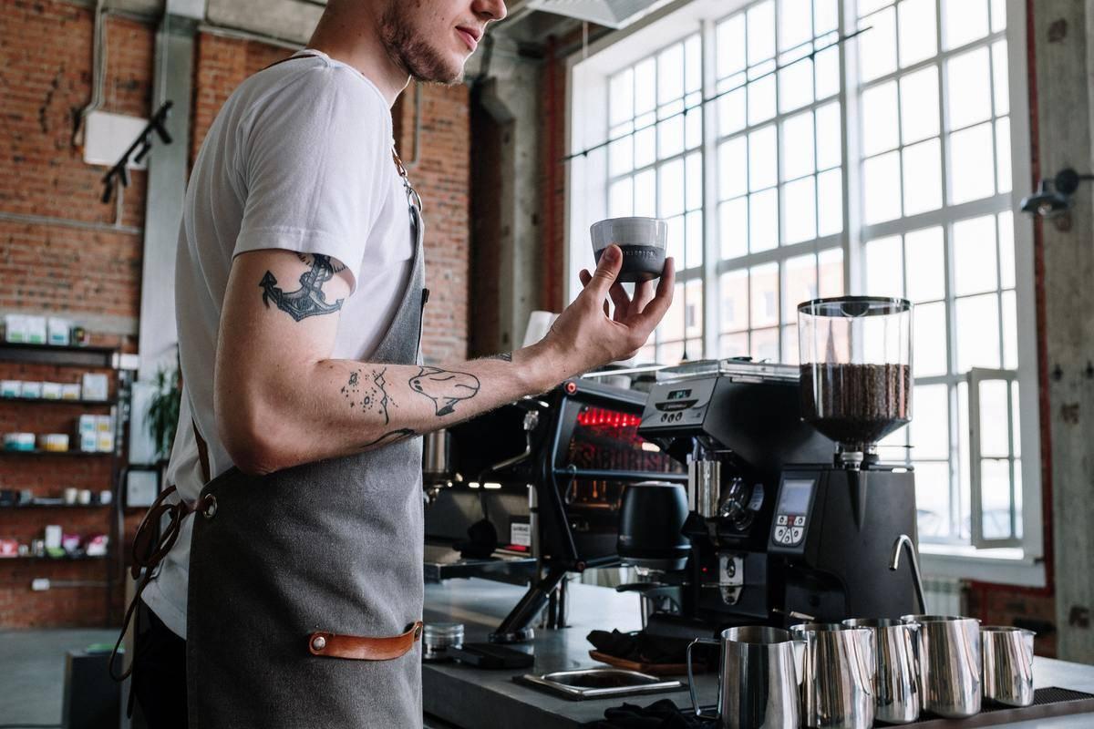 a barista making a coffee