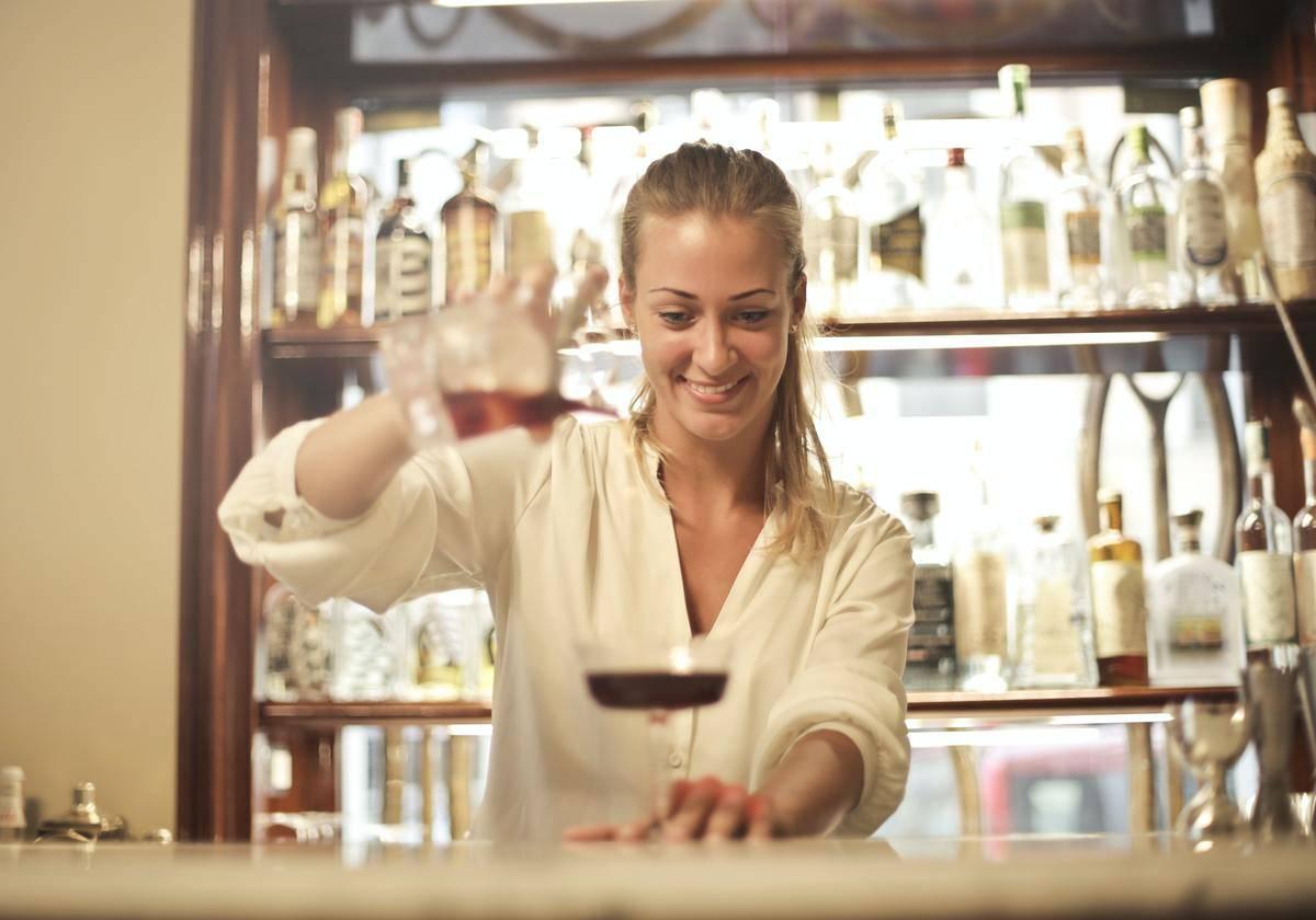 female bartender pouring drink