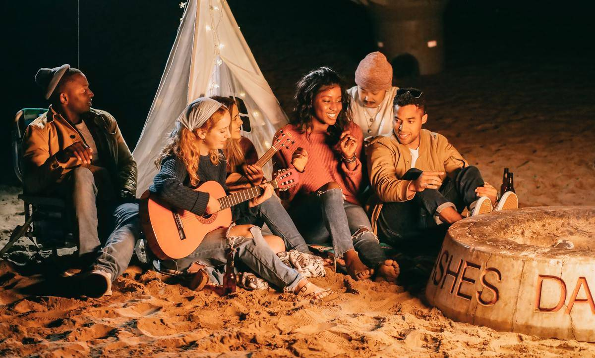 group of friends at bonfire