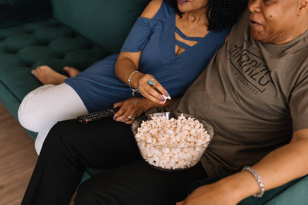 couple with popcorn on their laps
