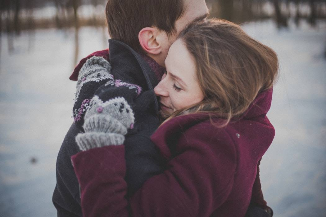 woman and man embracing in the winter