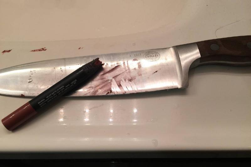 cut off lipstick with big knife