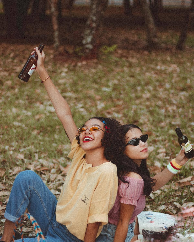 friends sitting on a blanket in a field