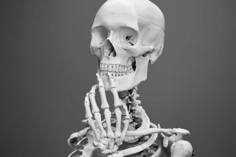 human skeleton in pensive position