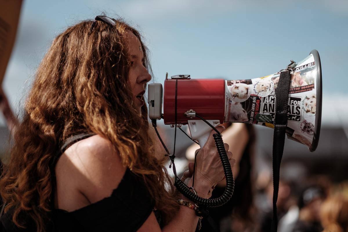 woman speaking into megaphones