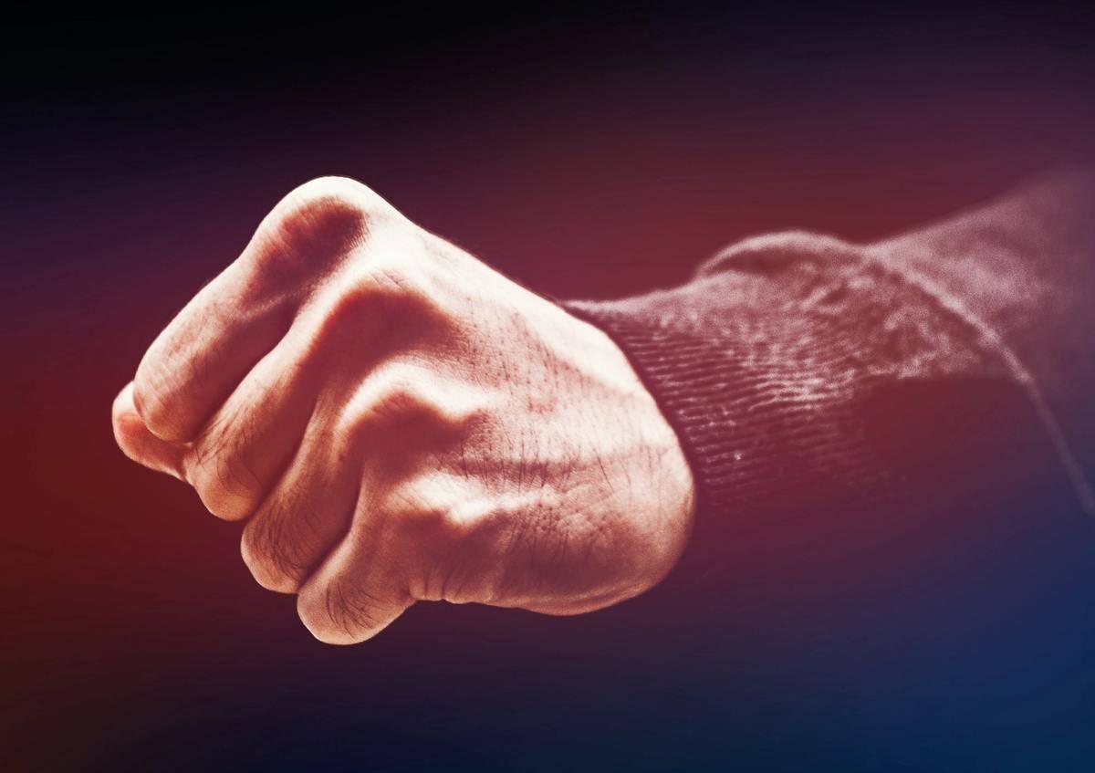 man's hand in fist