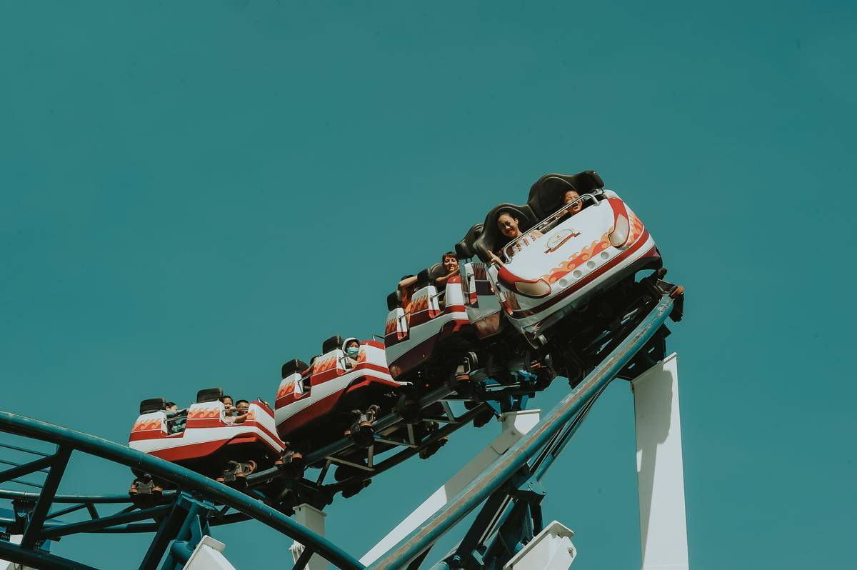 shot from below of orange and white rollercoaster car