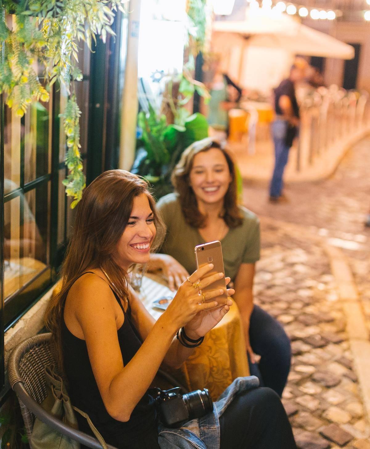 friends taking a selfie on a patio