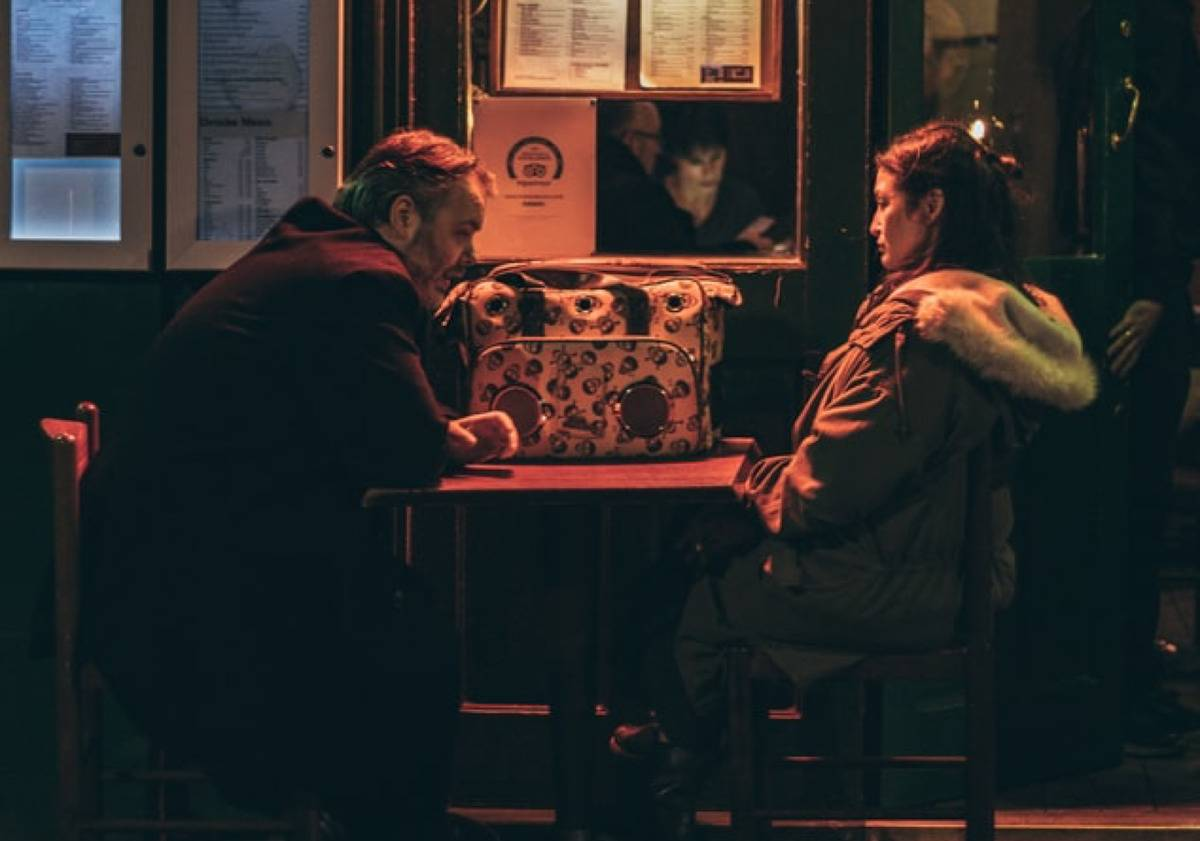 two people having a serious discussion in a bar