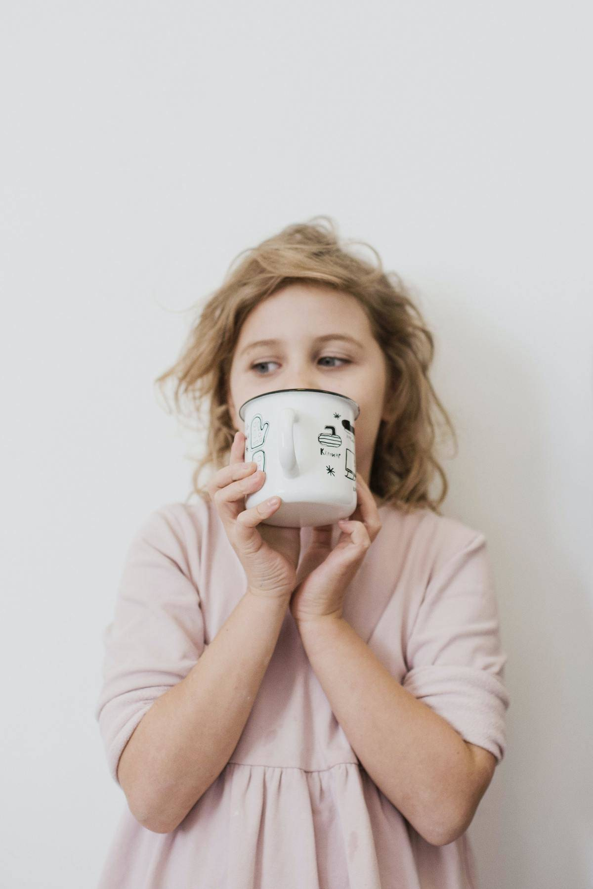 woman sipping from a coffee mug