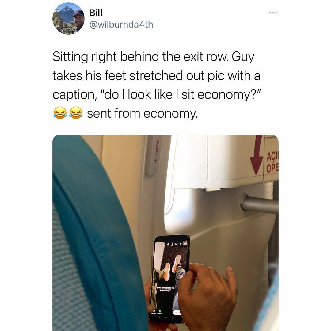Tweet: Sitting behind the exit row. Guy takes his feet stretched out pic with a caption,
