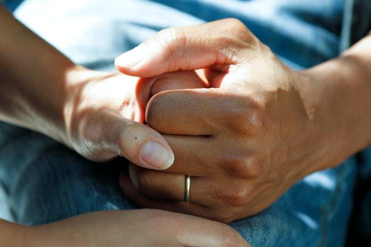 close up shot of two people holding hands