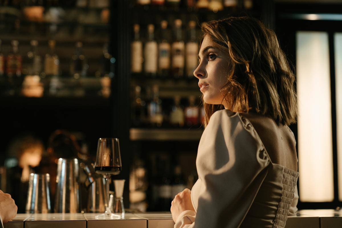 woman in bar looking to side