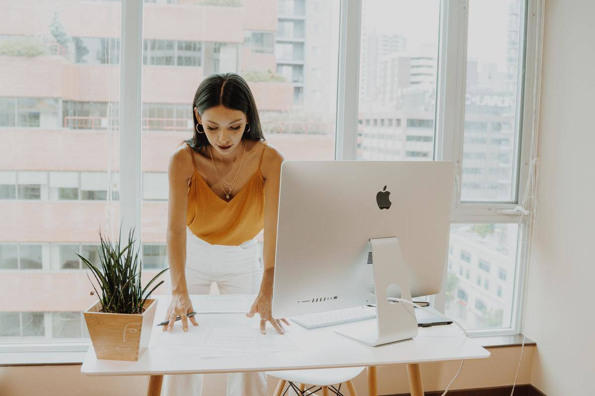 woman tidying up her desk in office