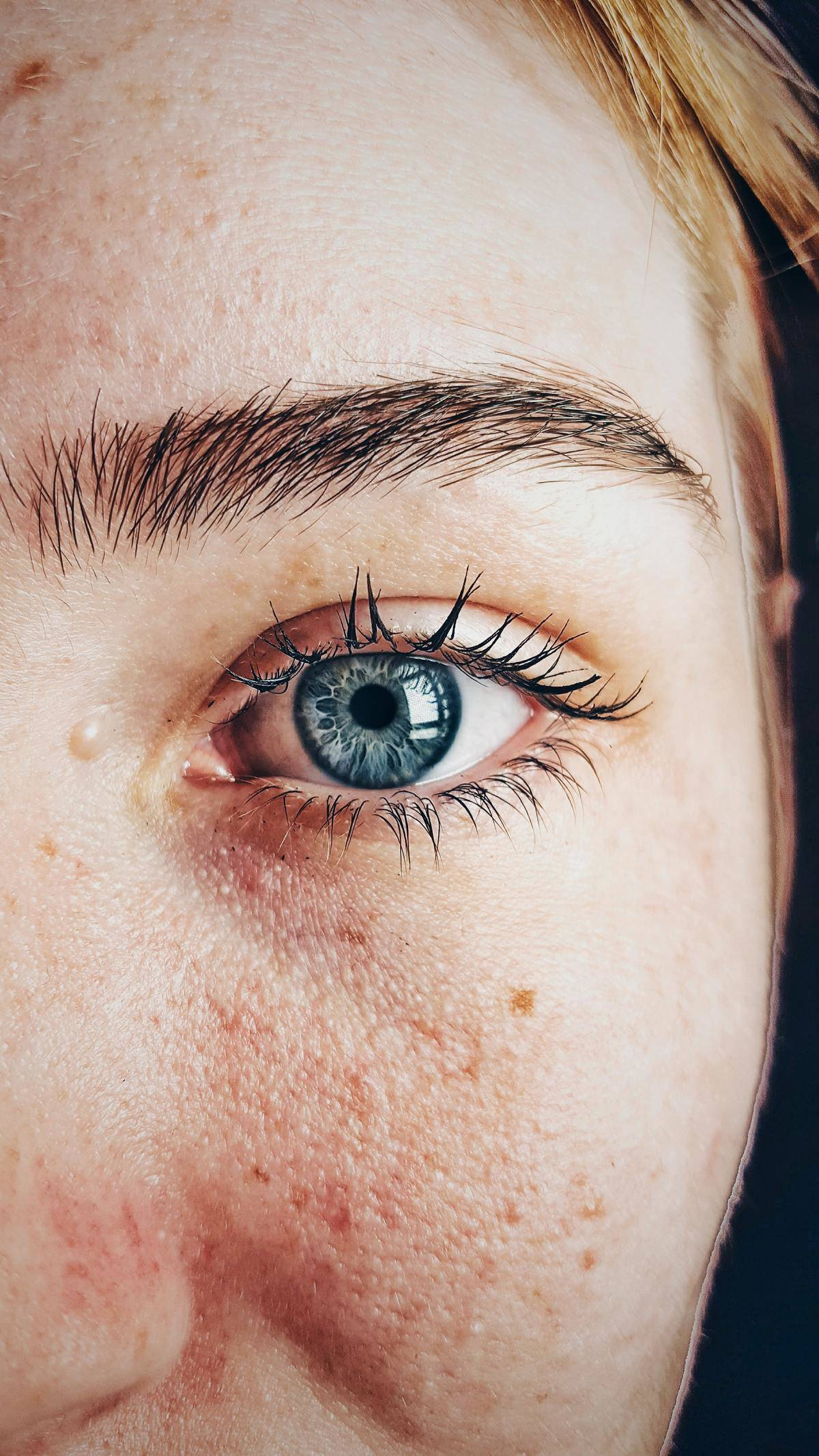 close up of woman's wet eye