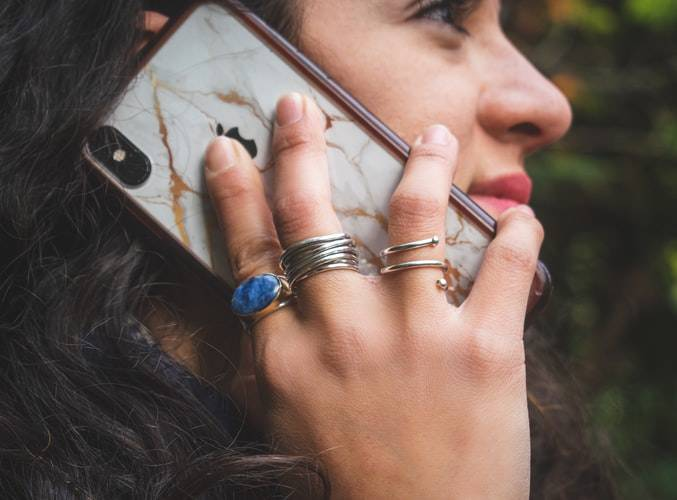 close up of woman calling someone on her iPhone