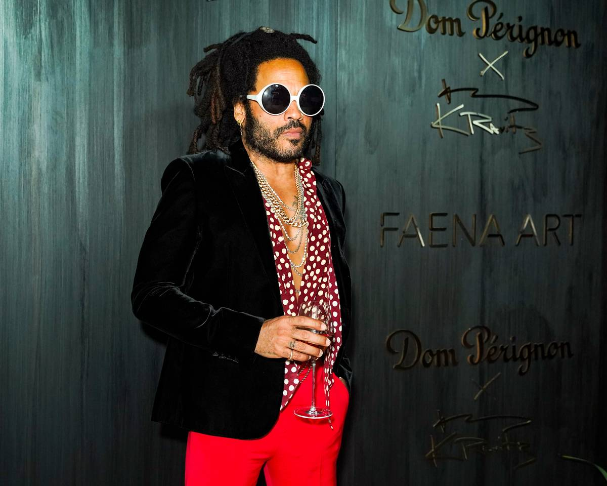 Lenny Kravitz posing with drink in his hand attends Dom Perignon Last Supper Party Hosted By Lenny Kravitz And Alan Faena on December 04, 2019 in Miami, Florida.