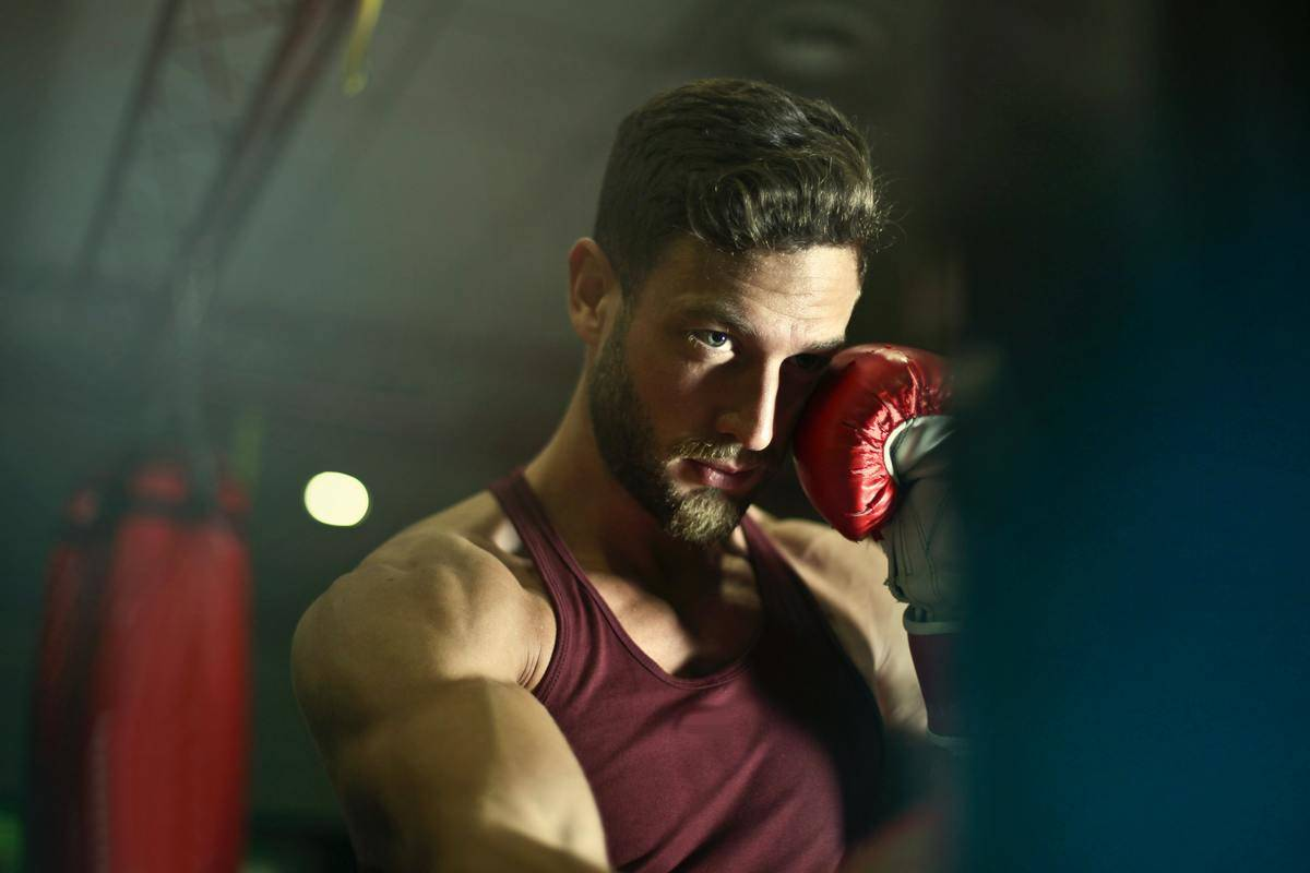 Man with boxing gloves, about to punch