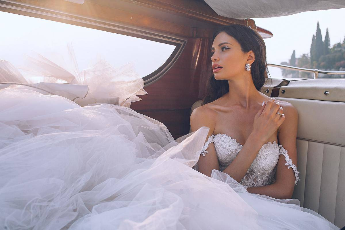 bride looking car window with mouth open