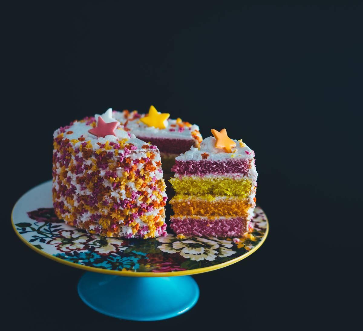 cutting colorful cake