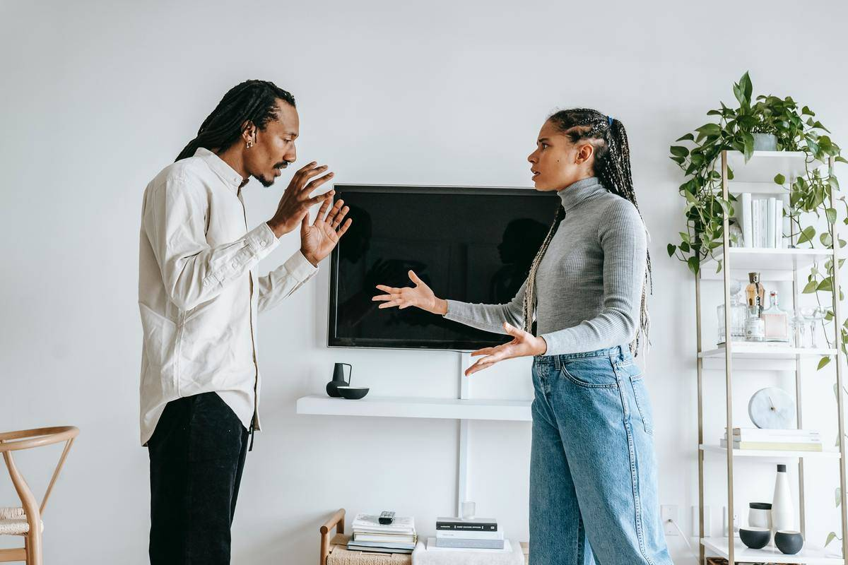 couple arguing hands gesturing at home
